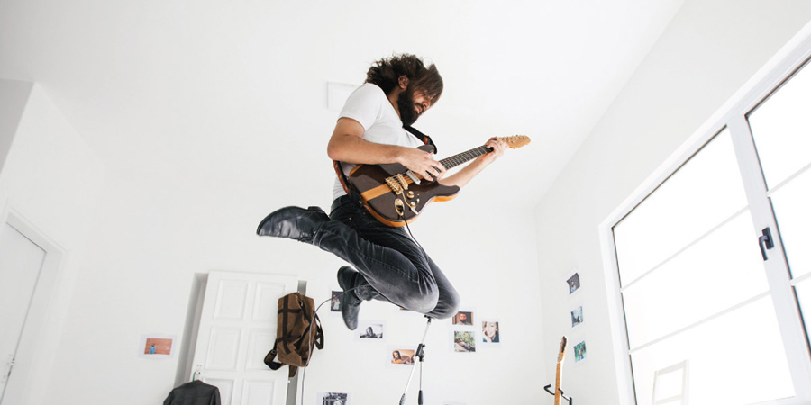 Guitarist air jump while playing